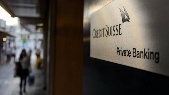 A sign of a Credit Suisse private banking branch is seen on May 19, 2014  in Geneva, Switzerland. The United States hit Credit Suisse with criminal charges for helping rich Americans evade taxes, ahead of an expected guilty plea by the giant Swiss bank and a $2.6 billion fine.  AFP PHOTO / FABRICE COFFRINI        (Photo credit should read FABRICE COFFRINI/AFP/Getty Images)