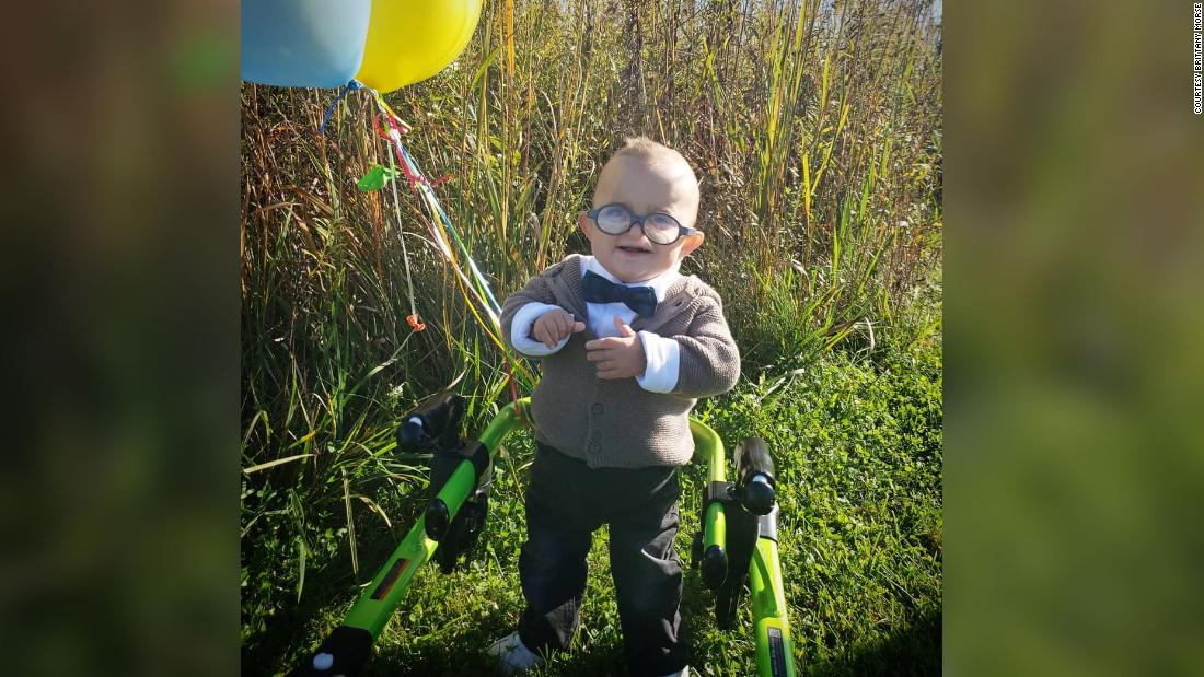 A toddler with cerebral palsy is taking Halloween to the next level with his 'Up' costume