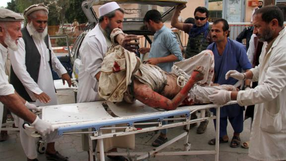 A man wounded in the attack is brought into a hospital in Jalalabad, east of Kabul, Afghanistan.