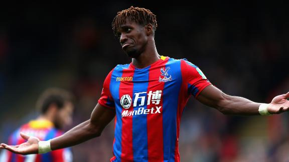 Wilfried Zaha of Crystal Palace has said he would consider walking off the field if subjected to racist abuse.
