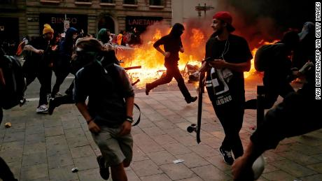 Protesters clash with police in Barcelona.