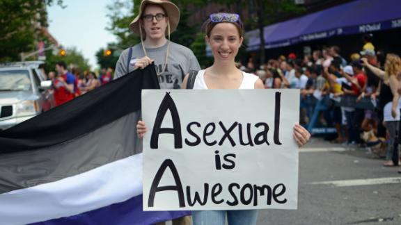 A woman holds a sign during the Queens Pride Parade in New York on June 2, 2013.