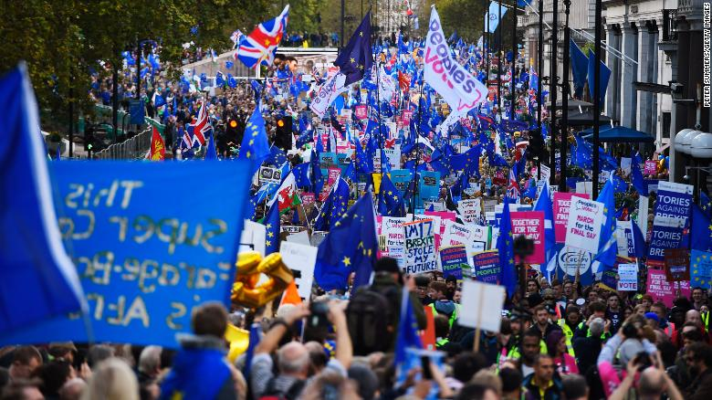 Crowds march through central London on Saturday to demand a People's Vote on the government's new Brexit deal.