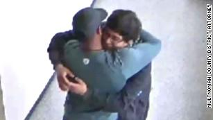 This football coach disarmed a student with a gun. Then he hugged him