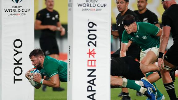 Ireland's centre Robbie Henshaw scores a try.