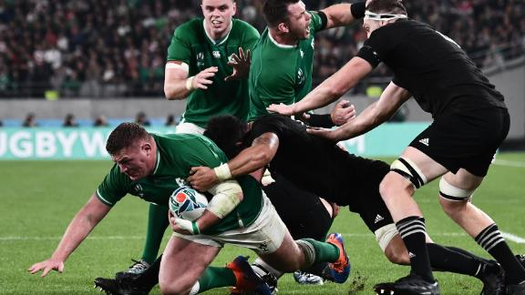 Ireland's prop Tadhg Furlong (L) is tackled.