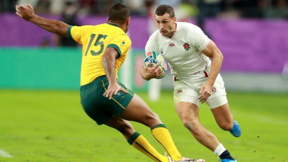 Jonny May of England takes on Kurtley Beale of Australia.