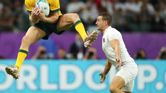 Reece Hodge of Australia claims a high ball under pressure from Jonny May of England.