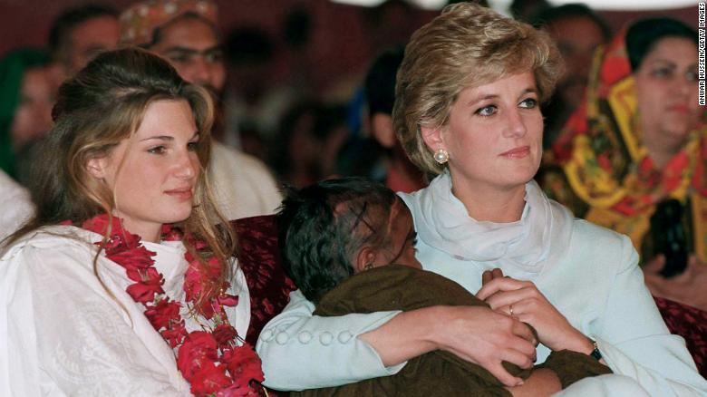 Diana, Princess of Wales, cradles a sick child as she sits beside Jemima Khan at Imran Khan's cancer hospital in 1996.