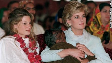 Diana, princess of Wales, weighs a sick child as she sits next to Jemima Khan at the Imran Khan Cancer Hospital in 1996.