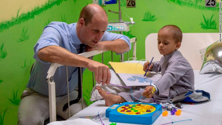 Prince William plays with 5-year-old Muhammed Sameer, a patient at Shaukat Khanum Memorial Cancer Hospital in Lahore on Thursday.