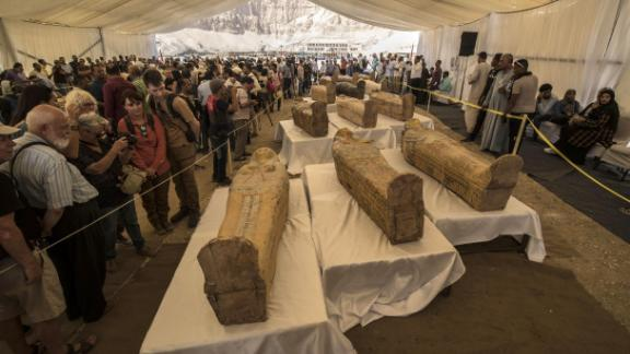 Tourists view the newly discovered coffins at Hatshepsut Temple on October 19, 2019.