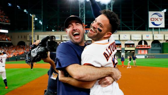 Houston Astros' Jose Altuve, right, and starting pitcher Justin Verlander celebrate after winning Game 6 of baseball's American League Championship Series against the New York Yankees.