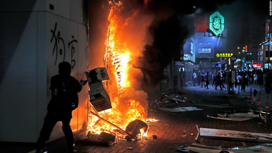 Protesters set fire to a shop on October 20.