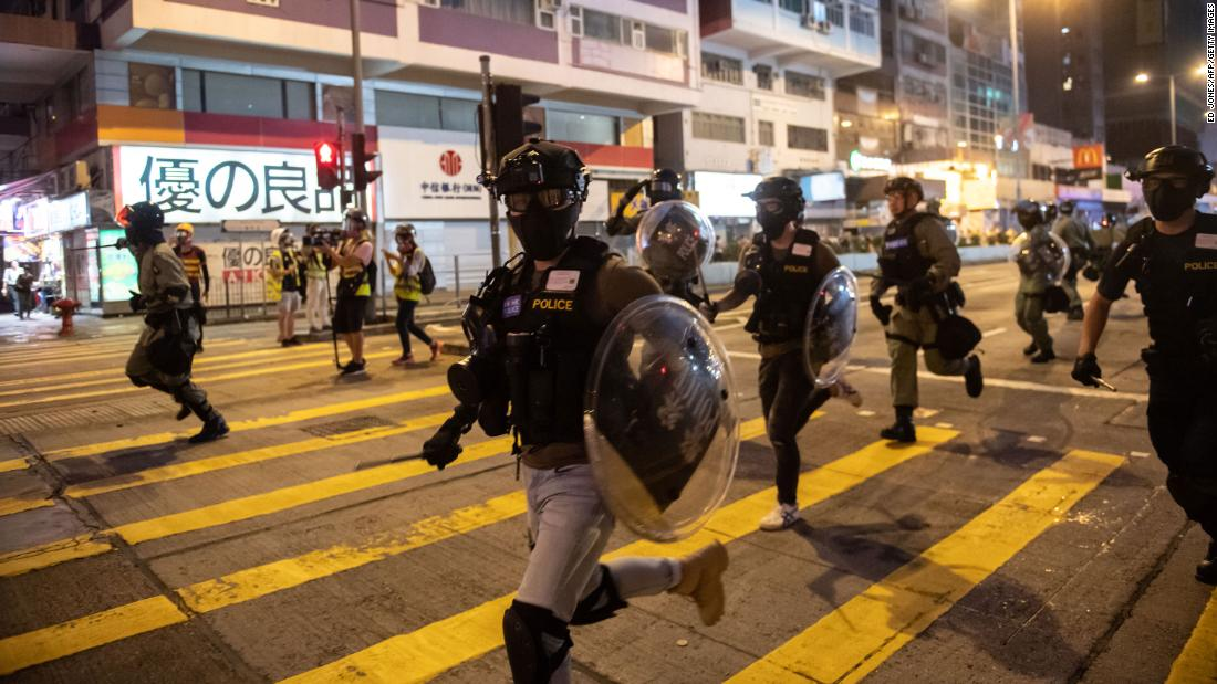 Police charge during a pro-democracy march in the Kowloon district on October 20.