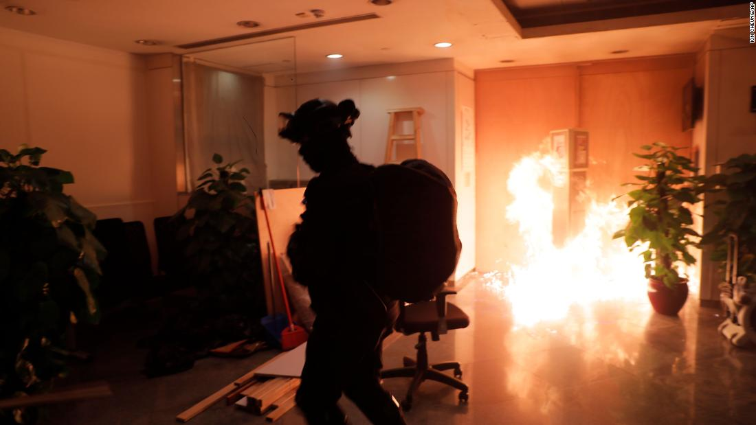 A protester sets fire to a Bank of China branch on October 20.