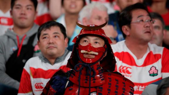Fans react during the Rugby World Cup quarterfinal match at Tokyo Stadium between Japan and South Africa.