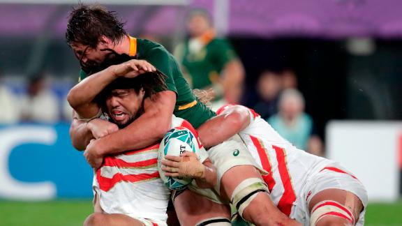 Japan's Shota Horie is tackled by South Africa's Eben Etzebeth.