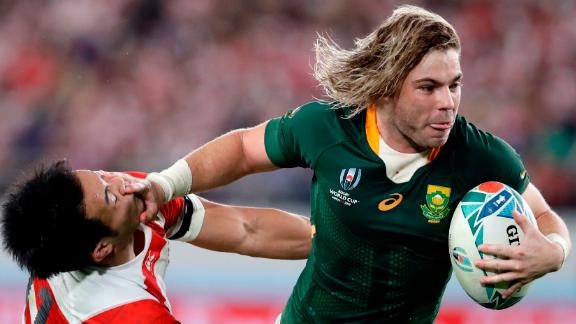 South Africa's Faf de Klerk runs to score a try during the Rugby World Cup quarterfinal match at Tokyo Stadium between Japan and the Springboks. South Africa won 26-3.