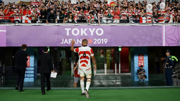Michael Leitch of Japan acknowledges the crowd whilst walking down the tunnel after the Brave Blossoms' defeat.
