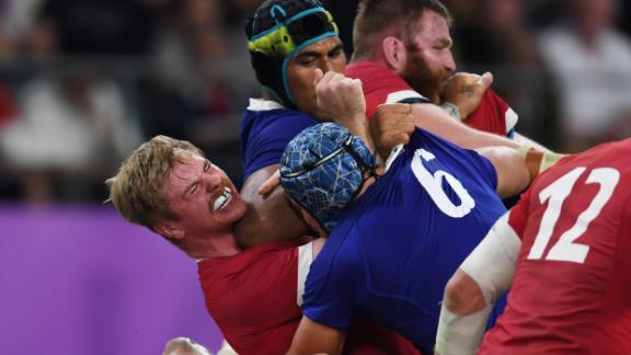 France's lock Sebastien Vahaamahina (black cap) elbows Wales' flanker Aaron Wainwright (L). Vahaamahina was red carded and his dismisall proved key as Wales took control of the match.