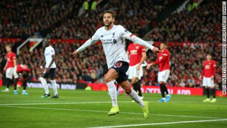 Adam Lallana celebrates scoring Liverpool's equalizer at Old Trafford.
