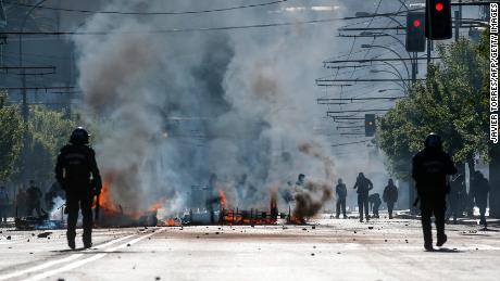 Demonstrators clash with riot police during protests in Valparaiso, Chile, on October 20, 2019.