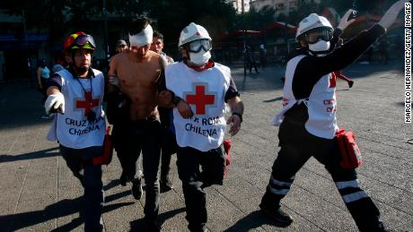 A person is injured during the protest on October 20, 2019 in Santiago, Chile.
