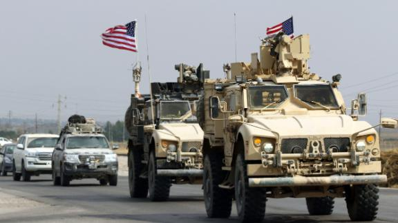 A convoy of US military vehicles arrives near the Iraqi Kurdish town of Bardarash in the Dohuk governorate after withdrawing from northern Syria on October 21, 2019. (Photo by SAFIN HAMED / AFP) (Photo by SAFIN HAMED/AFP via Getty Images)