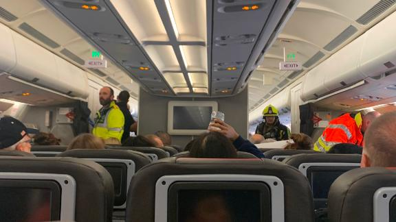 A photo sent to CNN by passenger Katie Phillips shows emergency personnel on the plane.