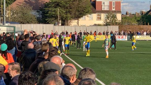 Haringey players congregate during a stoppage in the game vs. Yeovil.