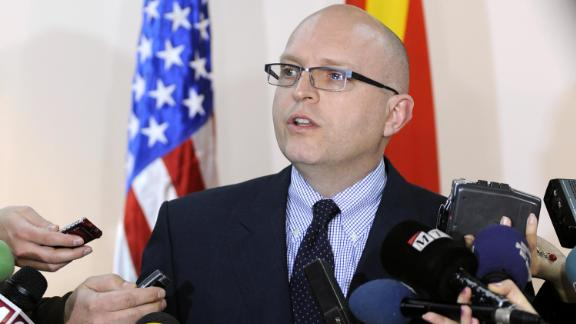 US Deputy Assistant Secretary for European and Eurasian Affairs Philip Reeker, center, talks to media in January 2012.