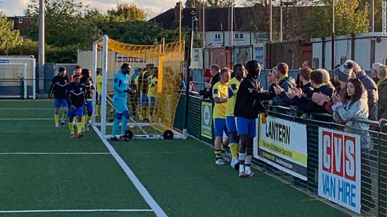 Haringey players shake hands with supporters.