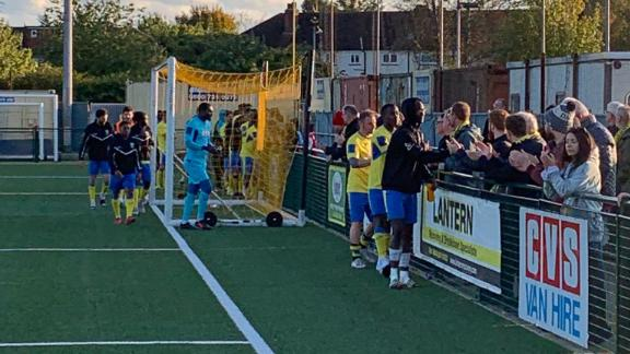Haringey players shake hands with their supporters.