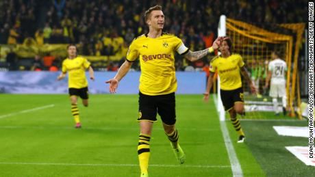 Marco Reus celebrates after scoring against Borussia Moenchengladbach.