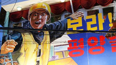 "A partially-obscured piece of North Korea-style propaganda reads: ""Look! It's the Pyongyang Pub!"""