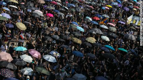 Protesters attend a pro-democracy march in Hong Kong on October 20.