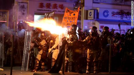 Police fire tear gas to disperse protestors in Hong Kong, Sunday, Oct. 20, 2019. Hong Kong protesters again flooded streets on Sunday, ignoring a police ban on the rally and setting up barricades amid tear gas and firebombs. (AP Photo/Mark Schiefelbein)