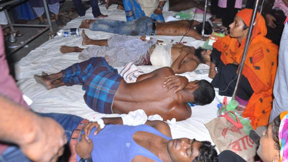 Demonstrators receive medical treatment in a hospital after police fired on people protesting over a Facebook post by a Hindu who allegedly defamed the Prophet Mohammed, inBarisal on October 20, 2019. - At least four people were killed and nearly 50 injured on October 20 after police fired on thousands of Bangladeshi Muslims protesting a Facebook post by a Hindu who allegedly defamed the Prophet Mohammed, officials said. (Photo by STR / AFP) / The erroneous mention[s] appearing in the metadata of this photo by MUNIR UZ ZAMAN has been modified in AFP systems in the following manner: [STR] instead of [MUNIR UZ ZAMAN]. Please immediately remove the erroneous mention[s] from all your online services and delete it (them) from your servers. If you have been authorized by AFP to distribute it (them) to third parties, please ensure that the same actions are carried out by them. Failure to promptly comply with these instructions will entail liability on your part for any continued or post notification usage. Therefore we thank you very much for all your attention and prompt action. We are sorry for the inconvenience this notification may cause and remain at your disposal for any further information you may require. (Photo by STR/AFP via Getty Images)