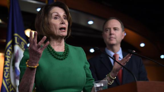 Speaker of the House Nancy Pelosi (L) holds a press conference with Chairman of the US House Permanent Select Committee on Intelligence, Adam Schiff, on Capitol Hill in Washington, DC, on October 15, 2019.