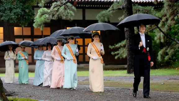 Japan's Crown Prince Akishino, right, and Crown Princess Kiko, second from right, arrive for the ceremony at Kashikodokoro, one of three shrines at the Imperial Palace.