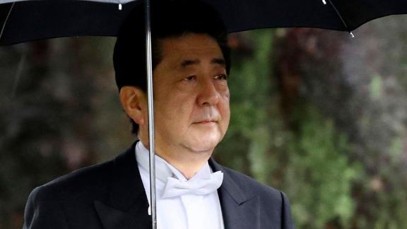 Japan's Prime Minister Shinzo Abe arrives for the ceremony at Kashikodokoro.