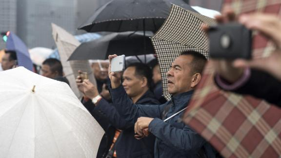 People photograph the Imperial Palace before Japan's Emperor Naruhito's proclamation of his ascension to the throne.