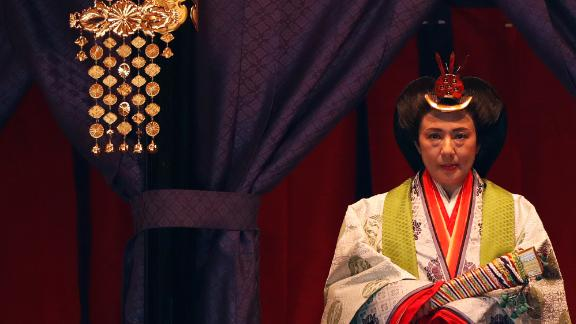 Japan's Empress Masako makes her appearance during a ceremony to proclaim Emperor Naruhito's enthronement.