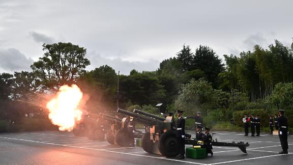 Japan Self-Defense Forces fire artilleries to mark the proclamation of Japan's Emperor Naruhito's ascension to the throne at a park in Tokyo.
