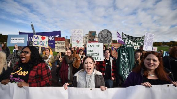 Abortion-rights demonstrators march through the streets of Belfast ahead of a meeting of the Stormont Assembly.