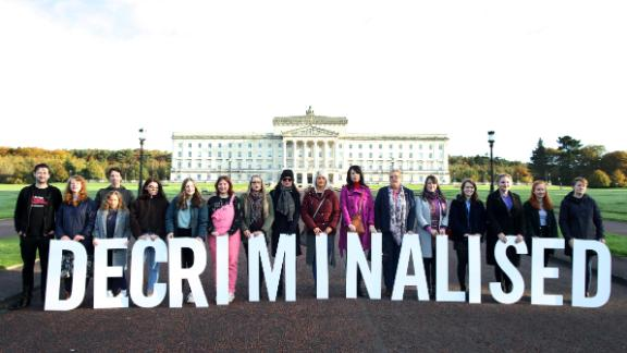 Abortion rights supporters pose outside Stormont in Belfast on Monday.