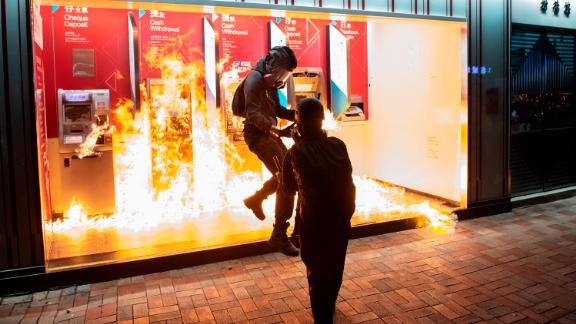 Protesters set a Bank of China branch on fire in Tai Wai, Hong Kong, during a demonstration earlier this month.