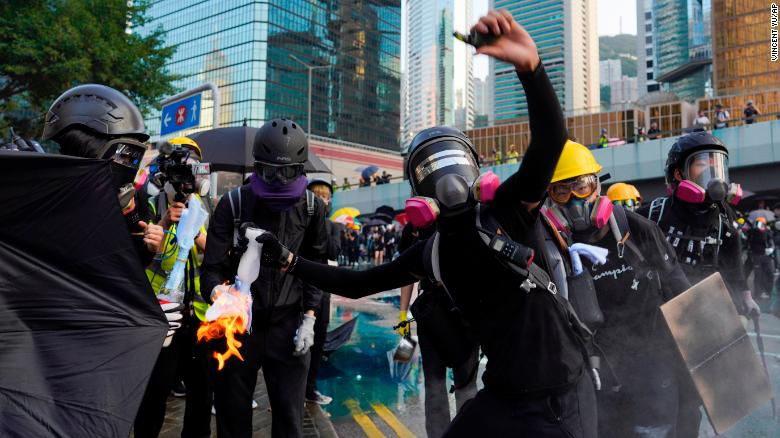 An anti-government protester throws a Molotov cocktail during a demonstration near Central Government Complex in Hong Kong, in September.