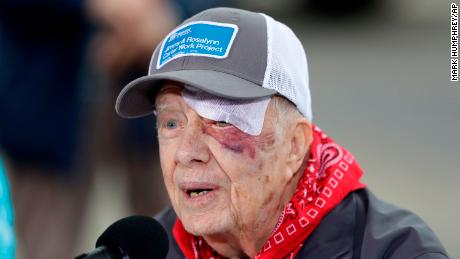 Former President Jimmy Carter answers questions during a news conference at a Habitat for Humanity project on October 7, 2019, in Nashville, Tenn. Carter wears a bandage after a fall the day before.